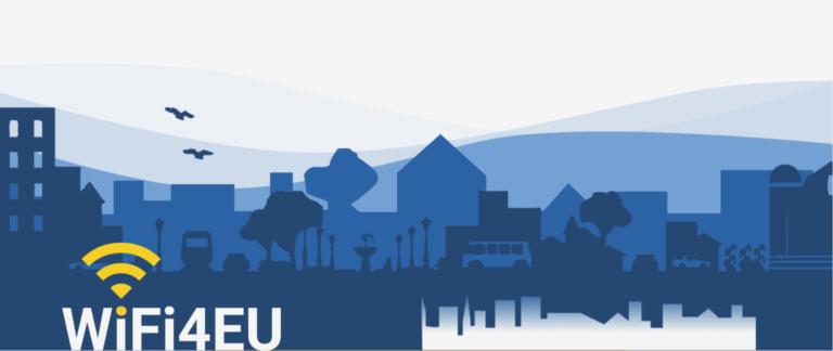 obraz na niebieskim tle z zabudowaniami z napisaem WIFI4EU i zółtym logiem wifi